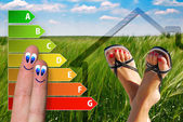 Diagram of house energy efficiency rating with two cute happy fingers and green background — Stock Photo