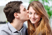 Handsome young man embracing his girlfriend with love — Stock Photo