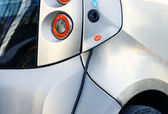 Close up on an electric car charge in filling station — Stock Photo