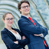 Expressive portrait Junior executives of company crossed arms — Stock Photo
