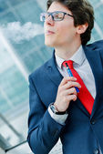 Cute young adult man inhaling from an electronic cigarette — Stock Photo