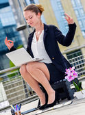 Junior executive of company doing yoga for relaxation — Stock Photo