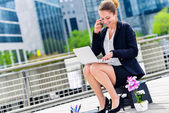 Junior executive dynamic working outside of her office — Stock Photo