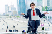 Junior executive dynamic working outside of his office — Stock Photo