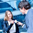 Junior executives dynamics exchange their business cards — Stock Photo #45533571