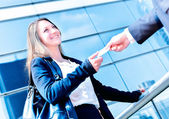 Junior executives dynamics exchange their business cards — Stock Photo