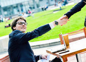 Junior executives dynamics shaking hands — Stock Photo