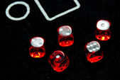 Red dices on casino table — Stock Photo
