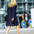Young business woman walking on the city street — Stock Photo #46418647