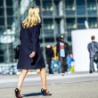 Young business woman walking on the city street — Stock Photo #46418653