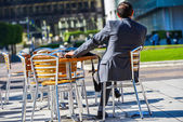 Modern businessman in the terrace of cafe — Stock Photo