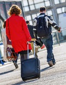 Business traveler woman walking with suitcase — Foto de Stock