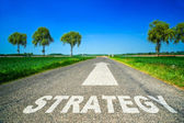 Strategy word painted on asphalt road — Stock Photo