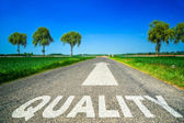 Quality word painted on asphalt road — Stock Photo