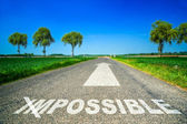 Possible word painted on asphalt road — Stock Photo