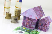 Real estate concept with Euro bank notes House and coins — Stock Photo