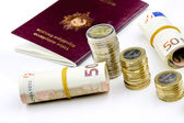 Passport and currency focuses on Euro banknotes — Stock Photo