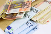 Envelope full of euro cash — Stock Photo