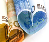 Two euro bill in the form of a heart — Stock Photo