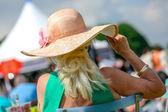 Elegant senior woman with her beautiful hat — Stock Photo