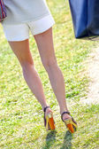 Beautiful legs of young woman — Stock Photo