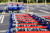 Row of shopping trolleys or carts in supermarket — Stock Photo