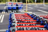 Row of shopping trolleys or carts in supermarket — Zdjęcie stockowe