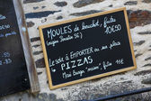 Menu board outside a French restaurant — Stock Photo