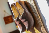 Traditional wooden shoes hanging on a wall — Stock Photo