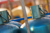 Stacks of gas cylinders on a distributor — Stock Photo