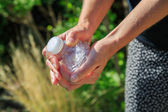 Woman crushing a plastic bottle — Stock Photo