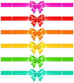 Bows with ribbons of warm colors — Stock Vector