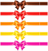 Silk bows in warm colors with ribbons — Stock Vector
