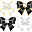 Stock Vector: White and black bows with diamonds and gold edging