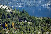 House on the mountain near the lake — Stock Photo