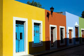 Colorful old one-story houses — Stock Photo