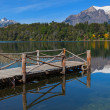 Wooden pier on a mountain lake — Lizenzfreies Foto