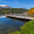 Wooden pier on a mountain lake — Stock Photo