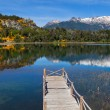 Wooden pier on a mountain lake — Foto Stock