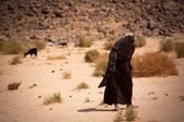 Woman in the desert — Stock Photo