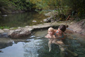 Mother and child are swimming in a thermic pool in national park Villarica, Chile — Stock Photo