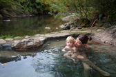 Mother and child are swimming in a thermic pool in national park Villarica, Chile — Stok fotoğraf