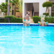 Child with mother in swimming pool — Stok fotoğraf