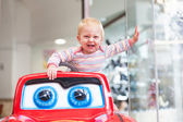 Baby playing with big toy car — Foto Stock