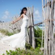 Beautiful bride posing at sea coast — Stock Photo