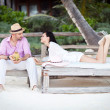 Couple relaxing on the beach — Stock Photo