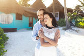 The couple of newly married stand on the beach — Stock Photo