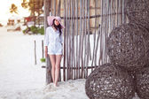 Beautiful young woman at the beach — Stock Photo