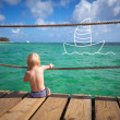 The child dreams on a sea beach — Stock Photo