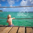 The child dreams on a sea beach — Stock Photo #40093489